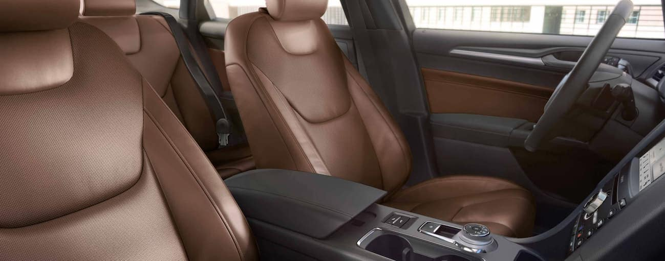 The brown and black leather front interior of a 2019 Ford Fusion.
