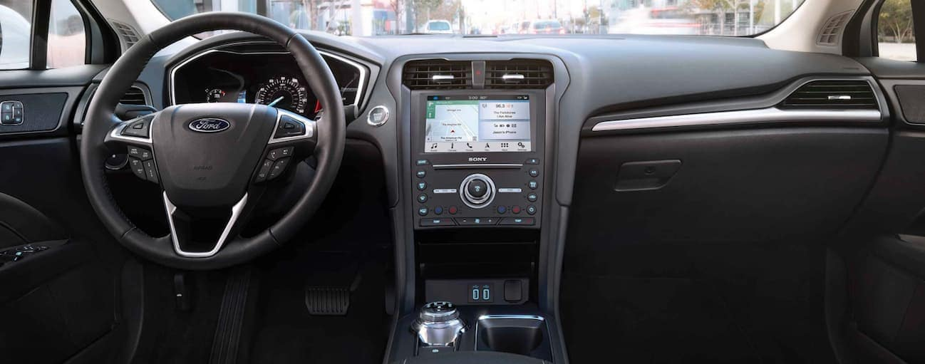 The black interior of a 2019 Ford Fusion is shown.