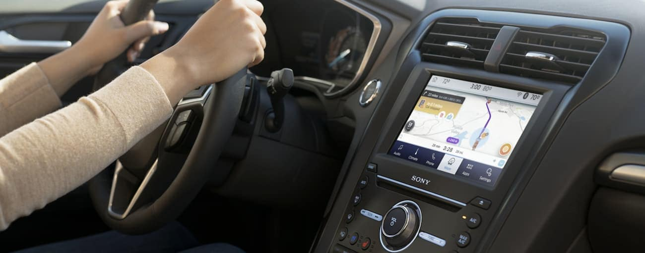 The interior technology features are shown inside a 2020 Ford Fusion.