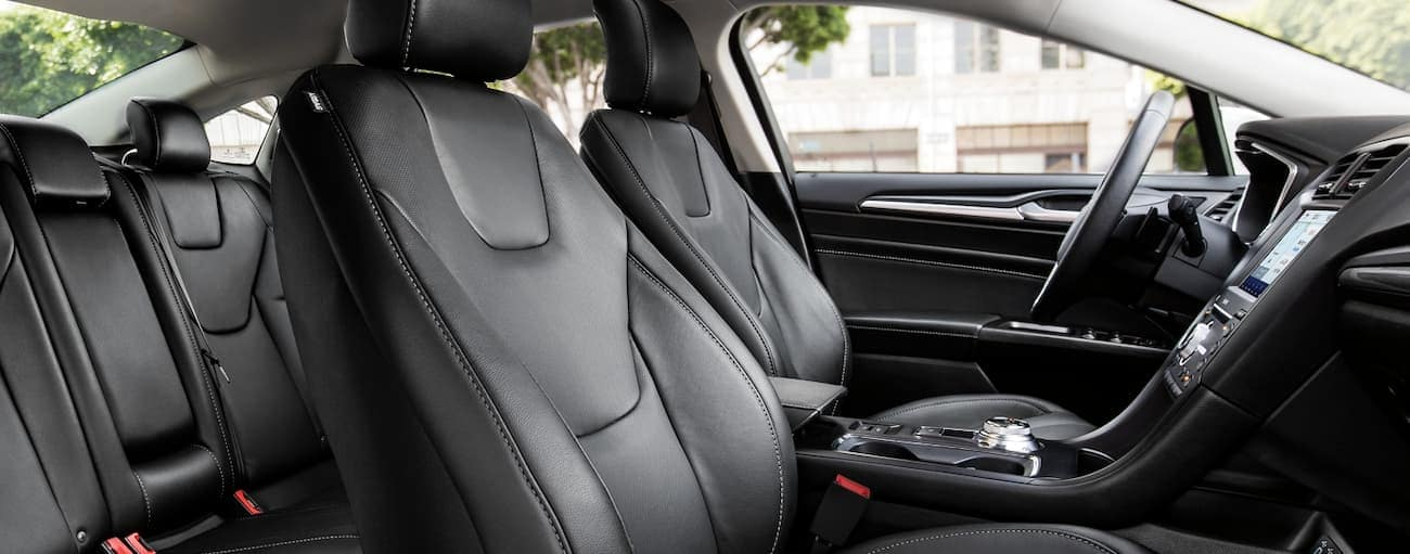 The black interior of the 2020 Ford Fusion , which wins when comparing the 2020 Ford Fusion vs 2019 Ford Fusion, is shown.
