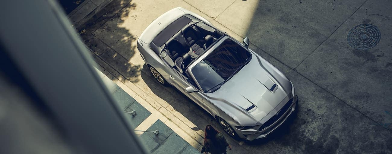 A silver 2020 Ford Mustang convertible is shown from above on a Cincinnati, OH street.