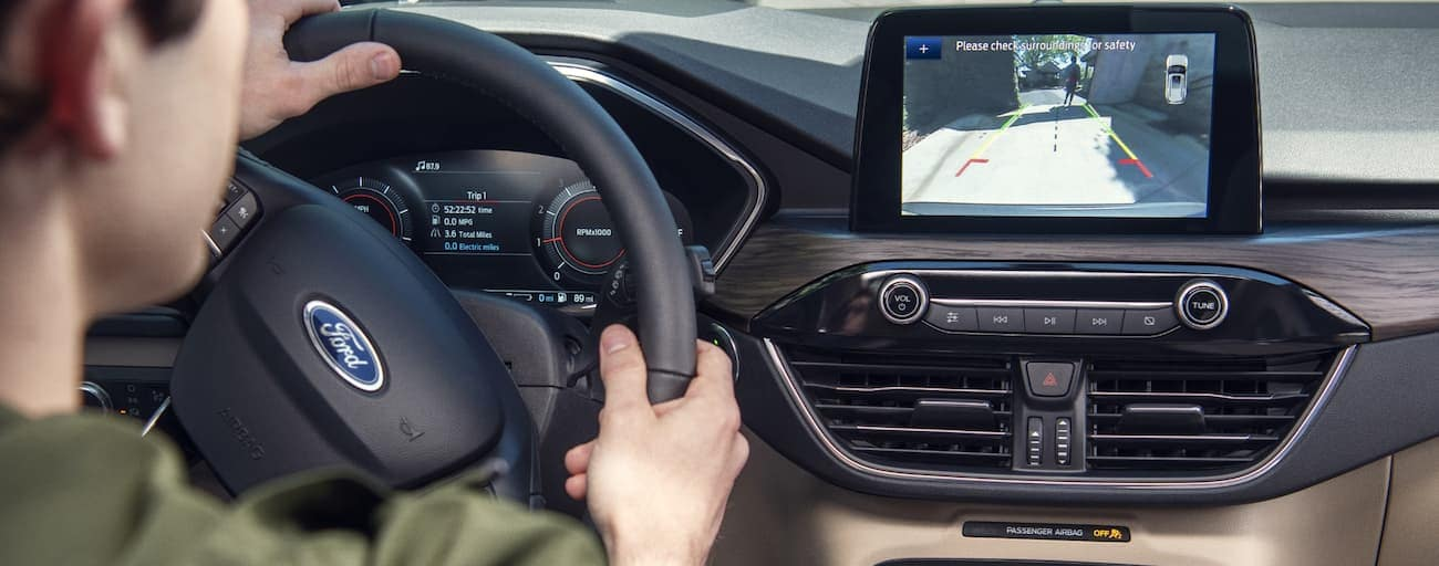 A close up the dash and infotainment system inside a 2020 Ford Escape is shown.