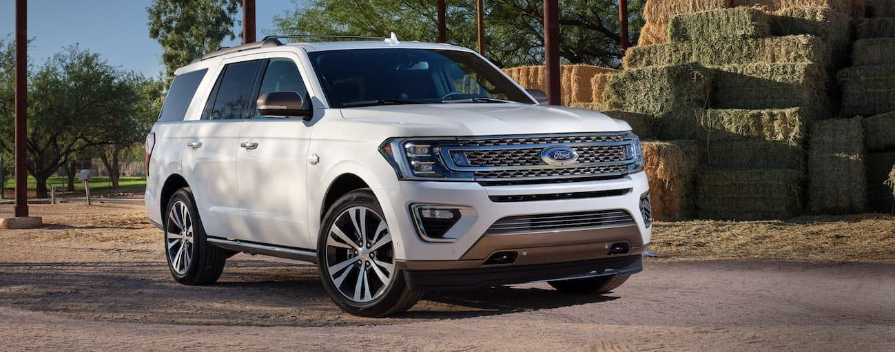 A white 2020 Ford Expedition is parked on a road next to bails of hay near Cincinnati, OH.