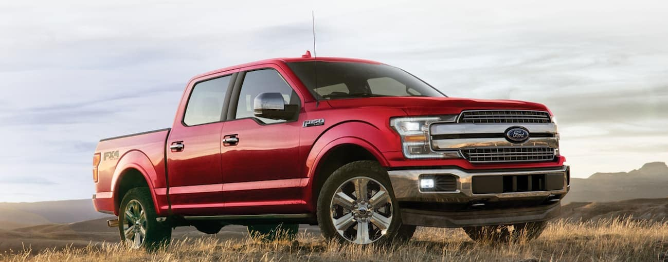A red 2020 Ford F-150 is parked in a grassy field near Cincinnati, OH.