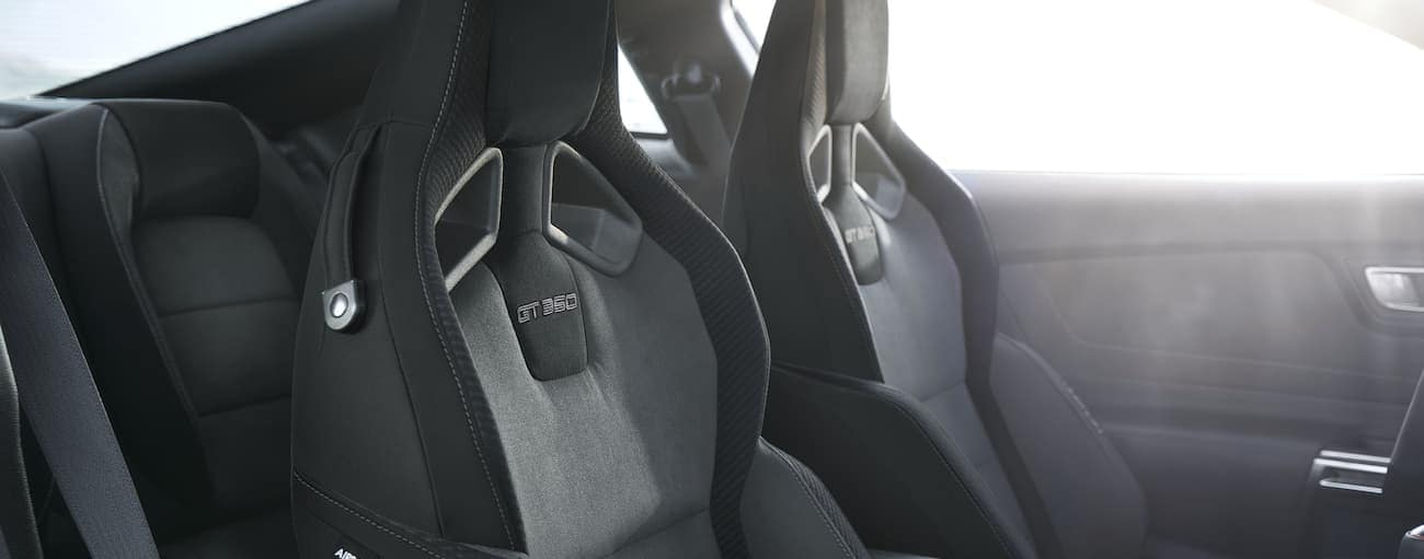 The two front racing style seats that can be found in a 2020 Ford Mustang Shelby GT350 are shown in black.