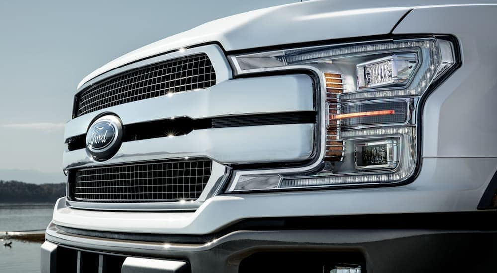 The grille of a white 2020 Ford F-150 is shown, which is popular at Ford dealers in Ohio.