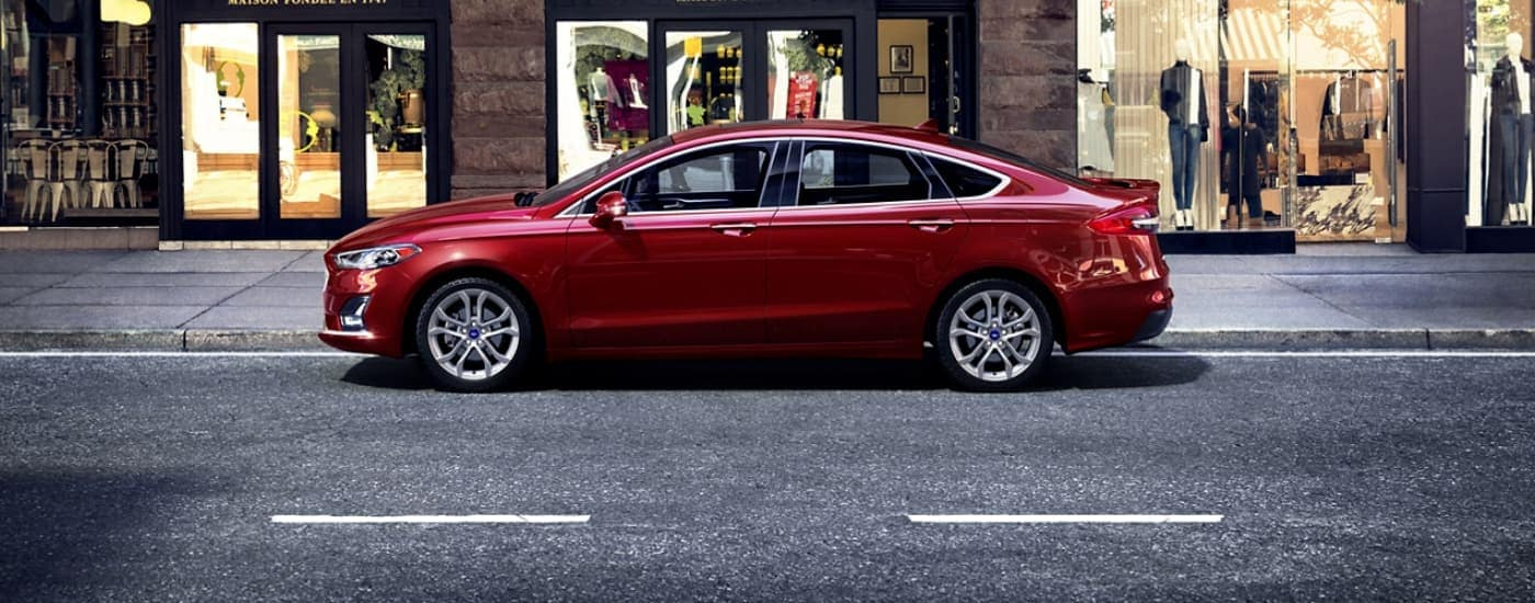 A red 2020 Ford Fusion is shown on a city street in Cincinnati, OH.