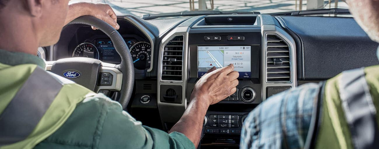 Two Cincinnati, OH, construction workers are using the infotainment system of a 2020 Ford F-150.