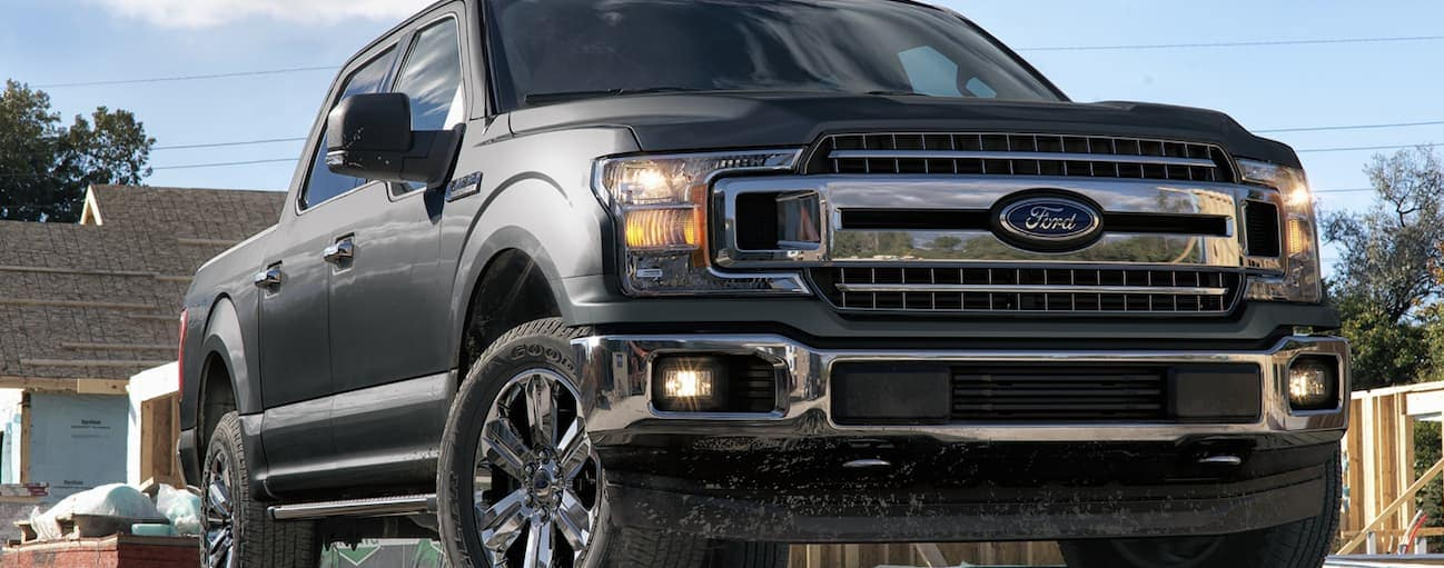 A grey 2020 Ford F-150, which wins when comparing the 2020 Ford F-150 vs 2020 GMC Sierra 1500, is parked at a construction site near Cincinnati, OH.