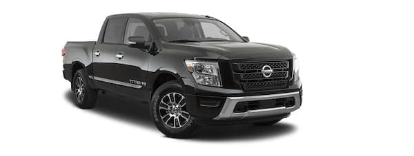 A black 2020 Nissan Titan is facing right.