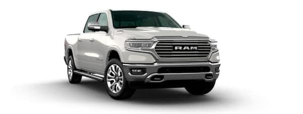 A white 2020 Ram 1500 is facing right.