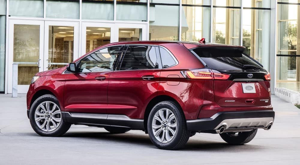 A red 2020 Ford Edge is parked outside of a glass building in Cincinnati, OH.