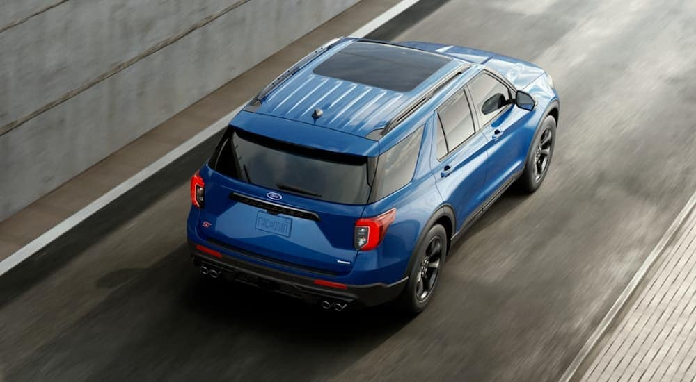 A blue 2020 Ford Explorer is shown from above on a highway.