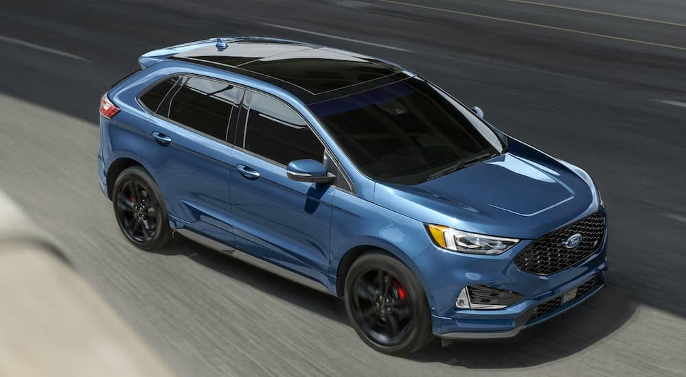 A birds eye view of a 2020 Ford Edge ST is driving on a road near Cincinnati, OH.