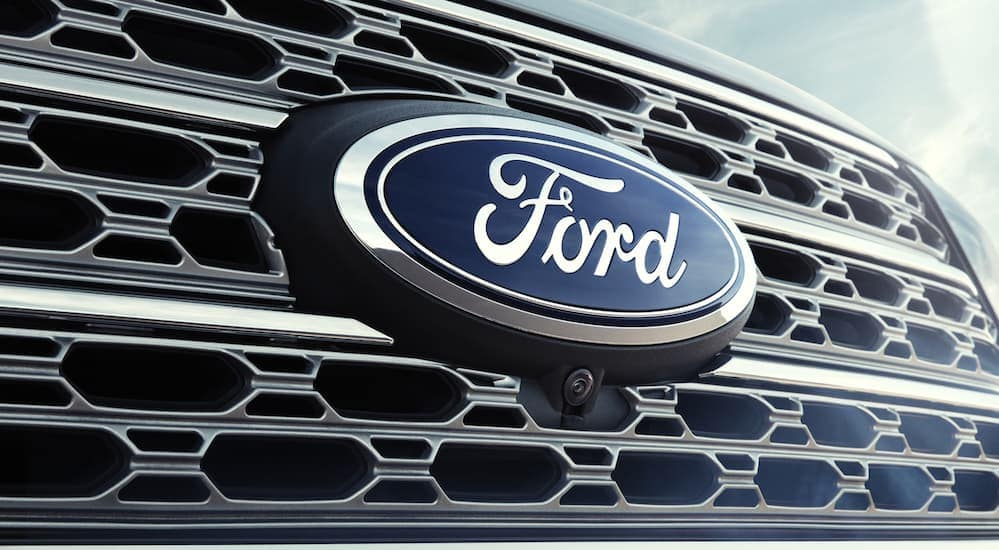 A close up of the Ford logo is shown.