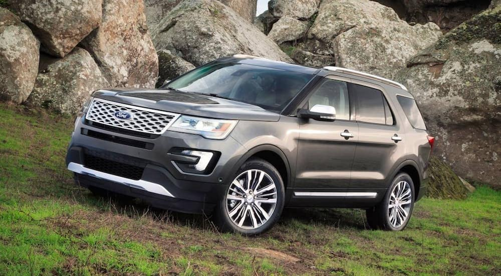 A grey 2017 Ford Explorer, which is a popular option among used cars in Cincinnati, OH, is parked next to large rocks on a hill.