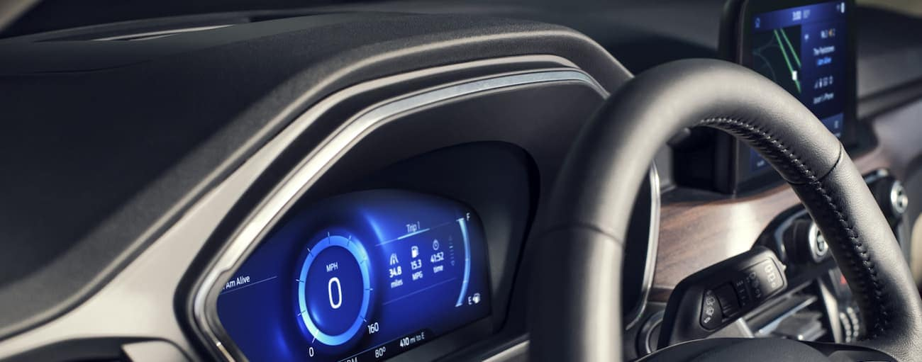 A close up of the drivers display and the infotainment system of the 2020 Ford Escape is shown.