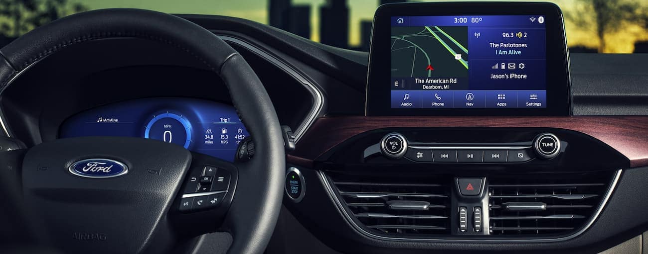 A close up of the drivers display and infotainment system of a 2020 Ford Escape is shown.