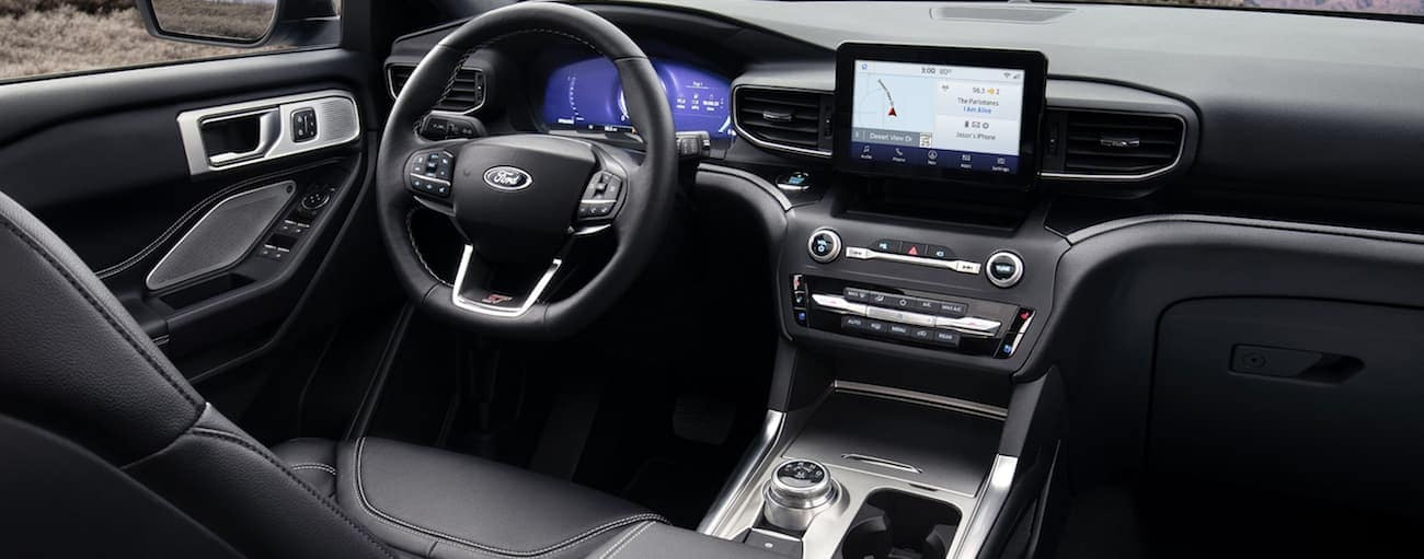 The front black leather interior of a 2020 Ford Explorer is shown.