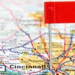 A map of Cincinnati, OH, is shown with a red flag marking it.