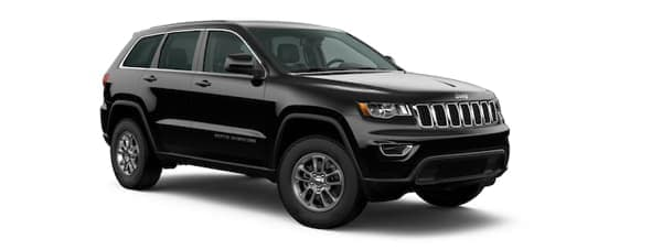 A black 2020 Jeep Grand Cherokee is facing right.