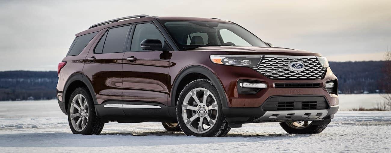 A burgundy 2020 Ford Explorer is parked on snow near Cincinnati, OH.