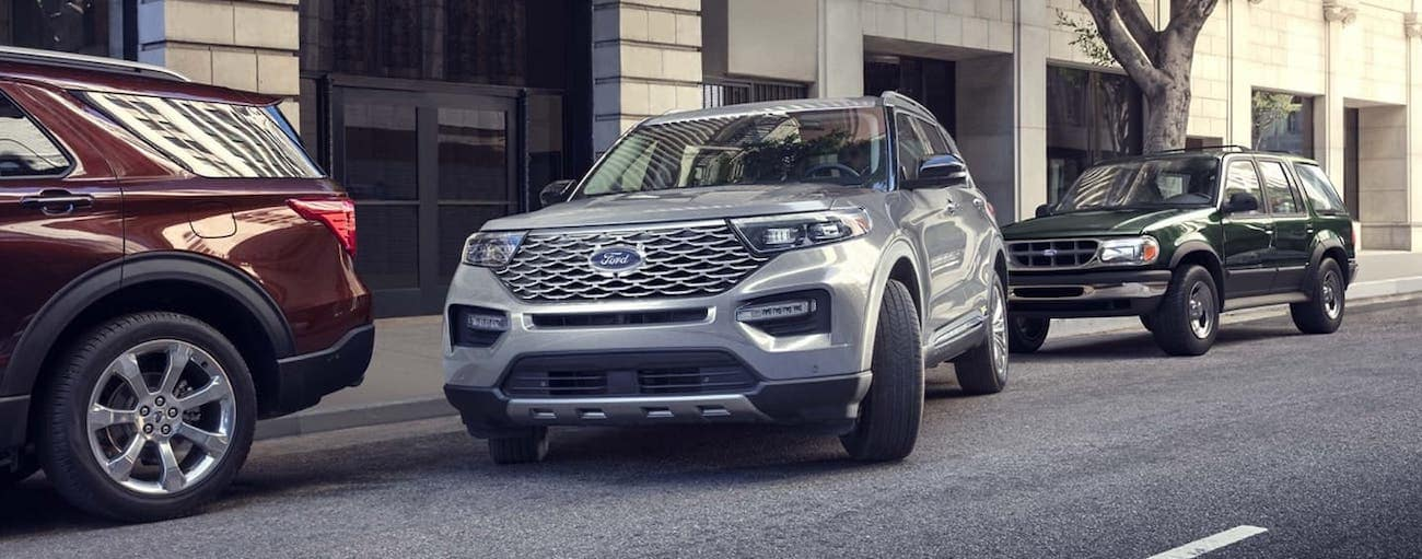 A silver Explorer is parallel parking on a city street after winning 2020 Ford Explorer vs 2020 Kia Telluride.