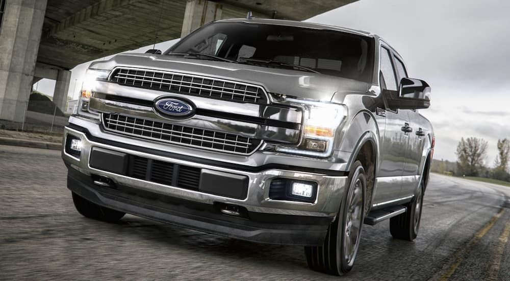 A silver 2020 Ford F-150 Lariat is drivin gon a highway near Cincinnati, OH.