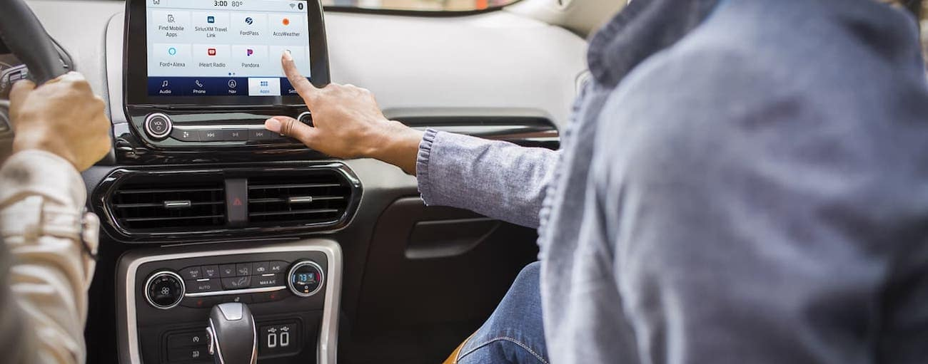A passenger is using the touchscreen in a 2020 Ford EcoSport.