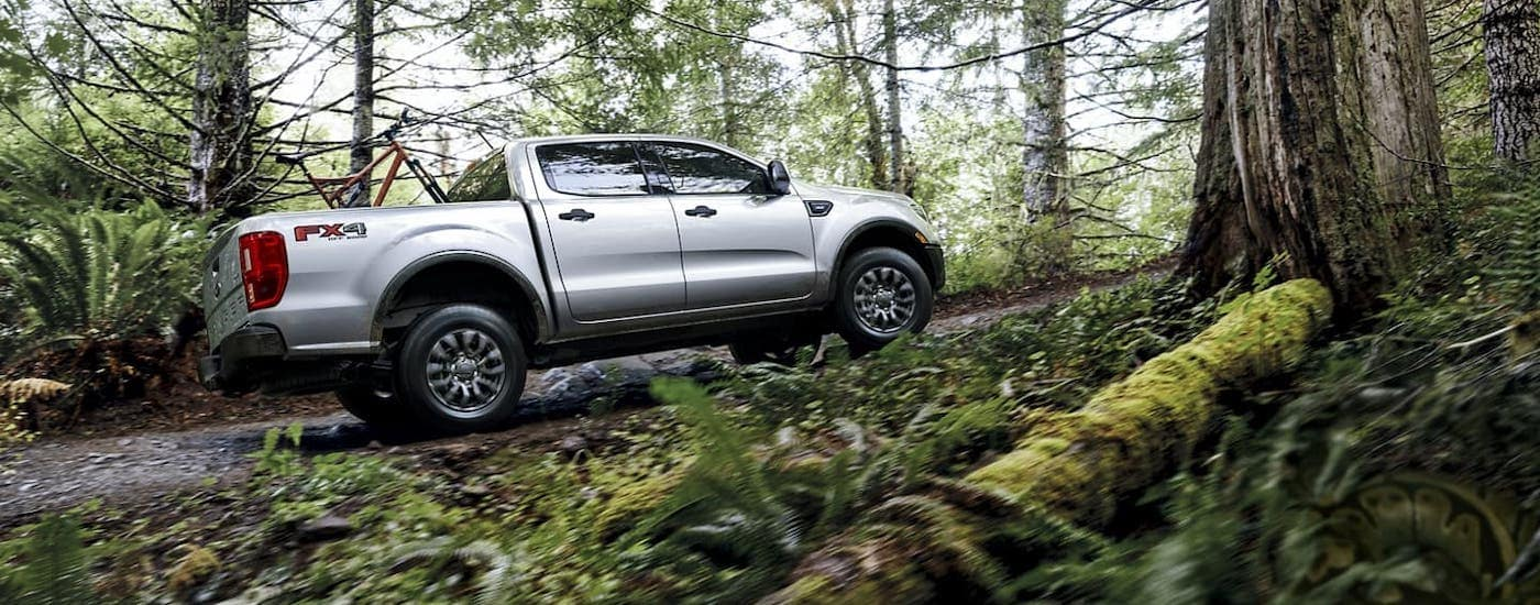 A silver 2020 Ford Ranger is off-roading in the woods near Cincinnati, OH.