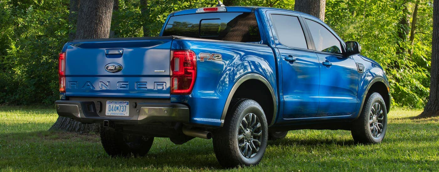 A blue 2020 Ford Ranger XL FX2 is shown from the rear while on grass.