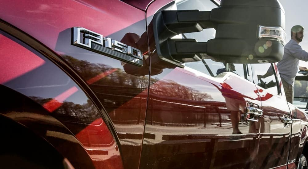 The side emblem on a red 2020 Ford F-150 is shown.