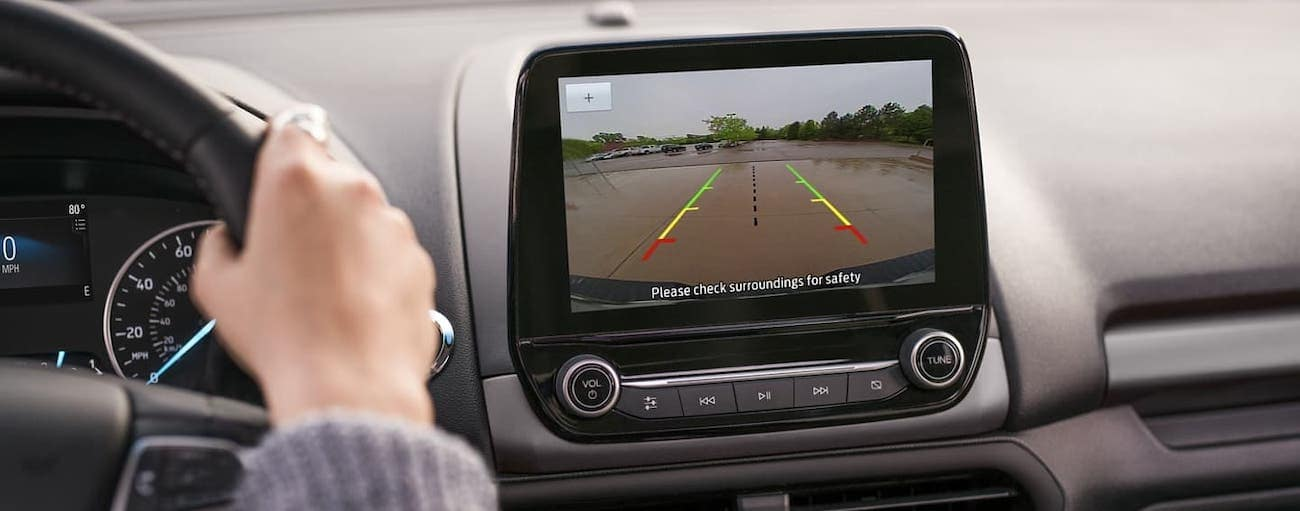 A driver is using the backup camera on a 2020 Ford EcoSport.