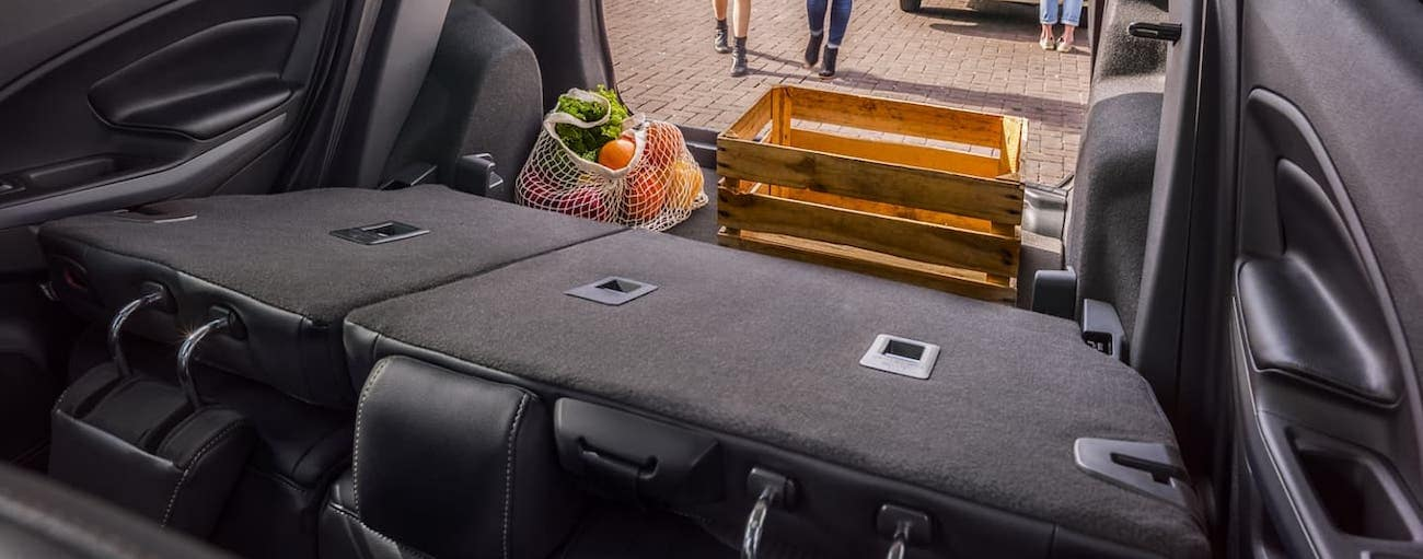 The back seats are folded down in a 2020 Ford EcoSport with boxes and groceries in the cargo area.