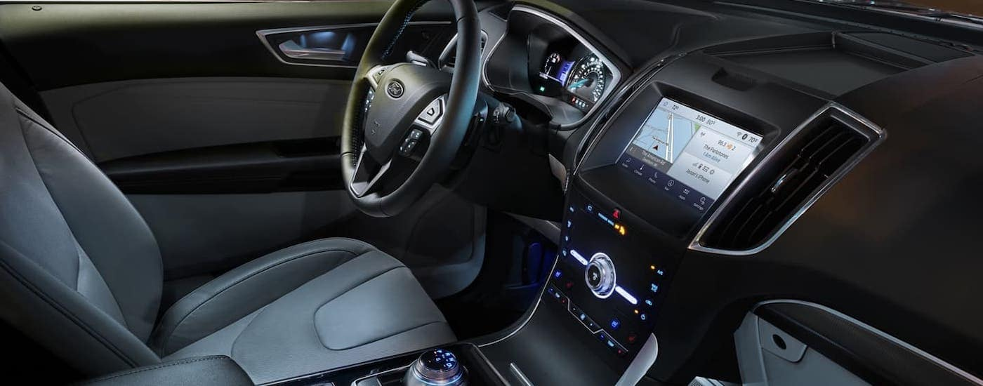 The interior and infotainment screen in a 2020 Ford Edge is shown.