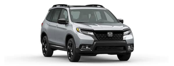 A silver 2020 Honda Passport is angled right on a white background.