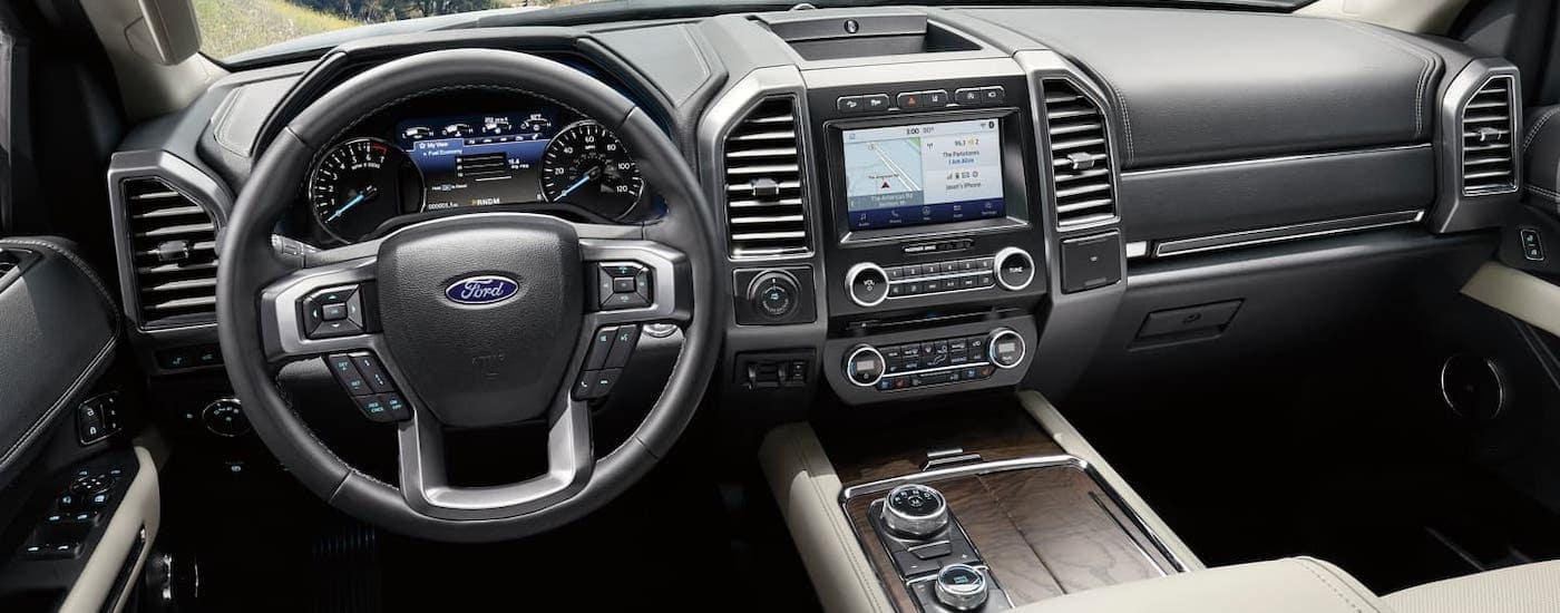The dashboard and front seats of a 2020 Ford Expedition are shown.