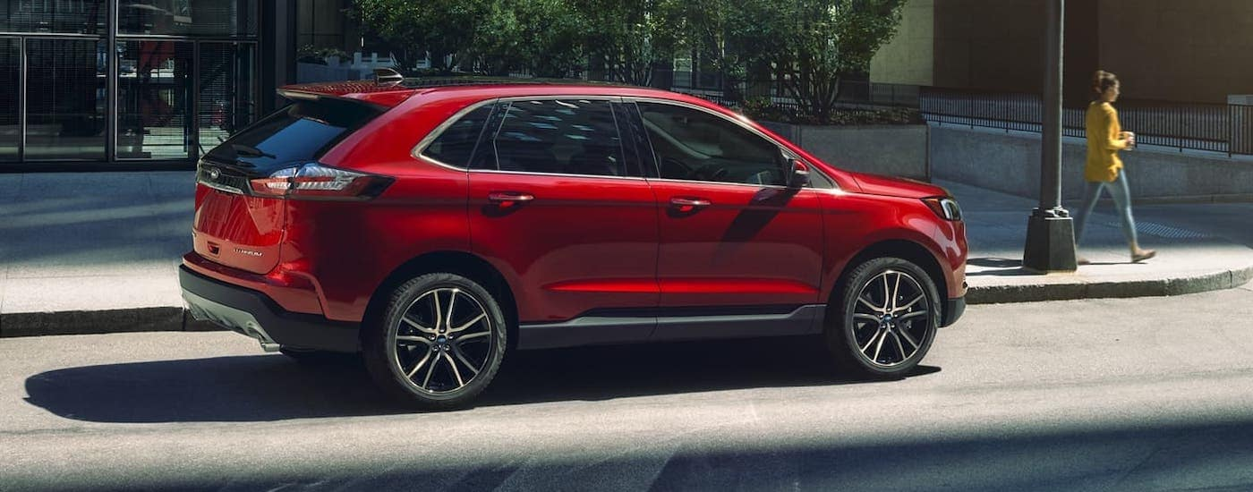 A red 2020 Ford Edge is parked on a Cincinnati street.