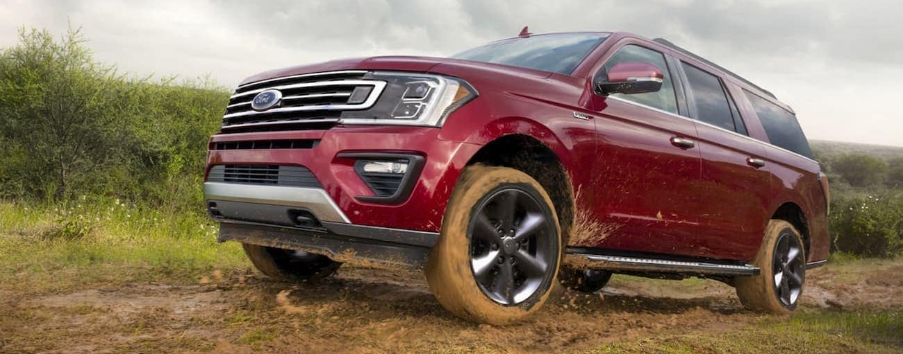A red 2020 Ford Expedition is off-roading in the mud outside of Cincinnati, OH, after winning the 2020 Ford Expedition vs 2020 Chevy Tahoe comparison.