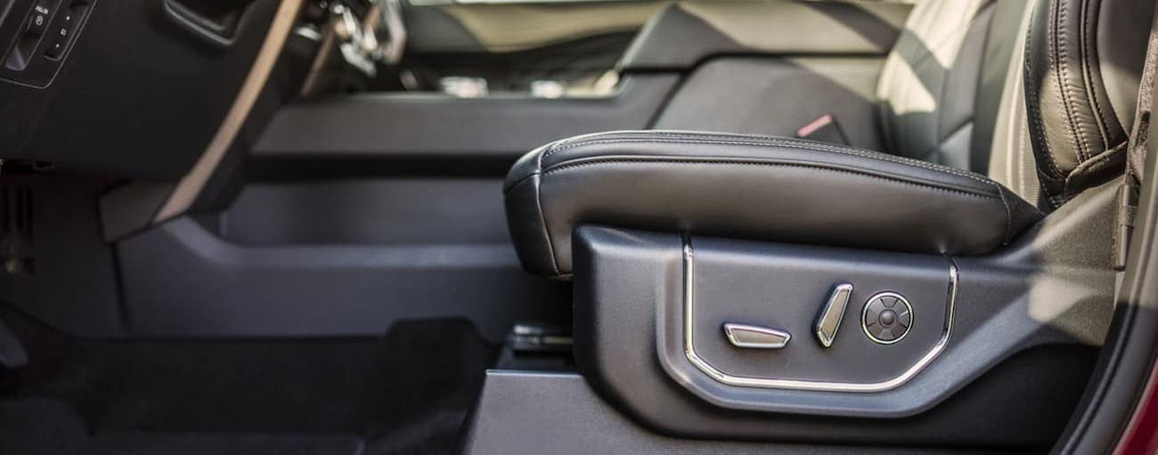 The driver's seat features are shown from the side in a 2020 Ford Expedition.
