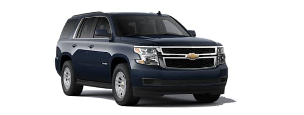 A blue 2020 Chevy Tahoe is angled right.