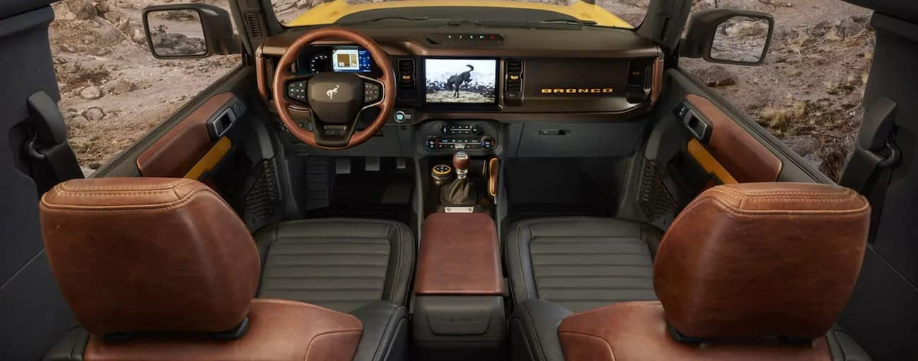 The brown and black interior of a 2021 Ford Bronco is shown.
