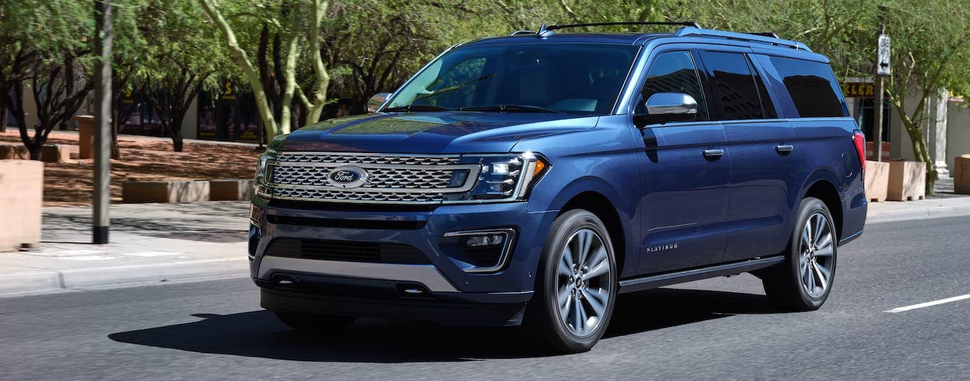 A blue 2020 Ford Expedition Platinum is driving on a street near Cincinnati, OH.