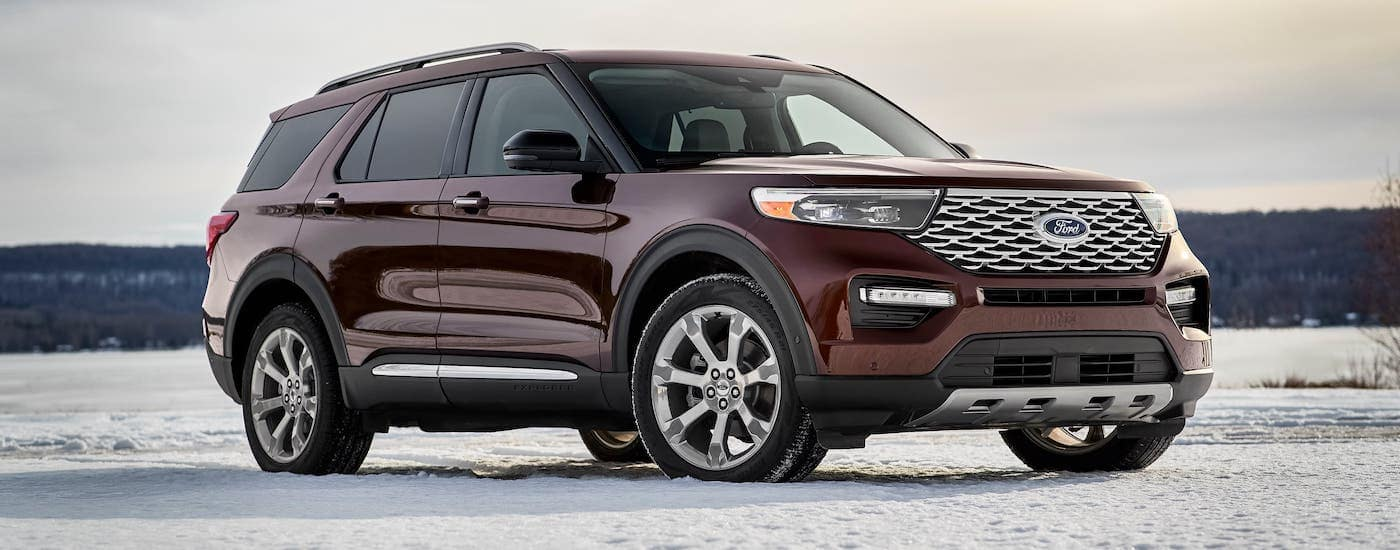 Is this the best SUV? A burgundy 2020 Ford Explorer is parked on a snowy field.