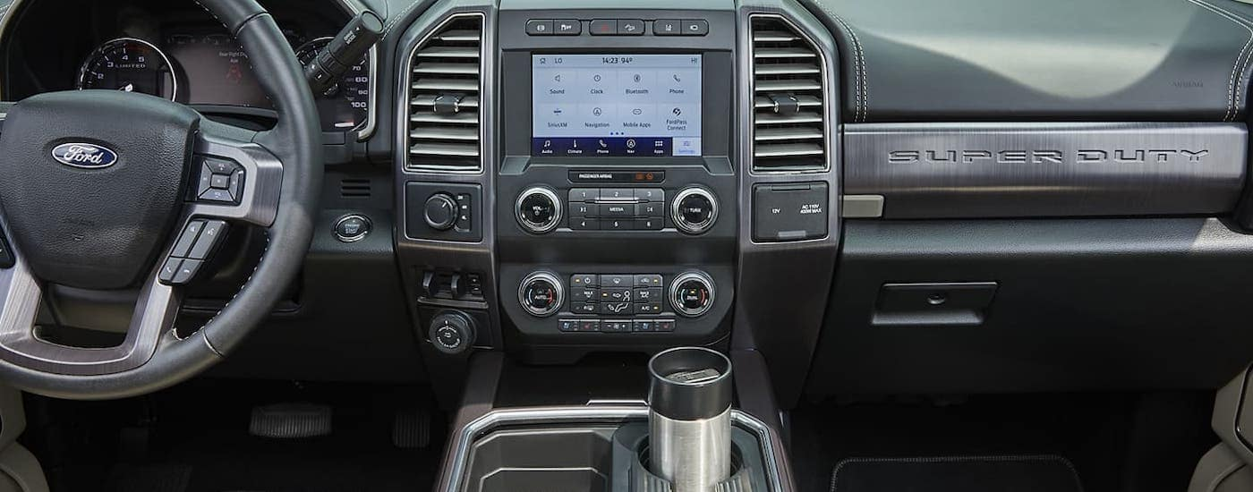 The infotainment screen and dashboard are shown inside a 2020 Ford F-250.
