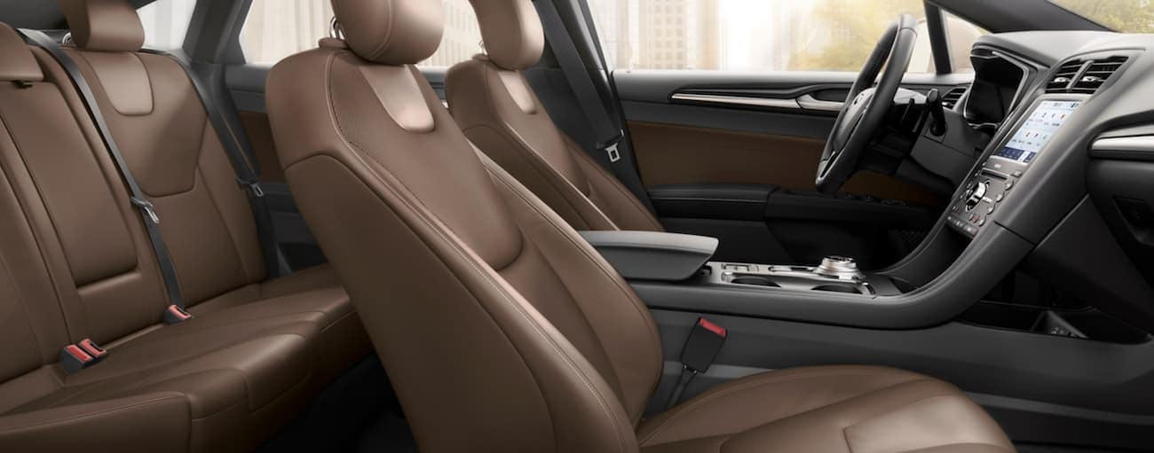 The brown interior of a 2020 Ford Fusion is shown from the side.
