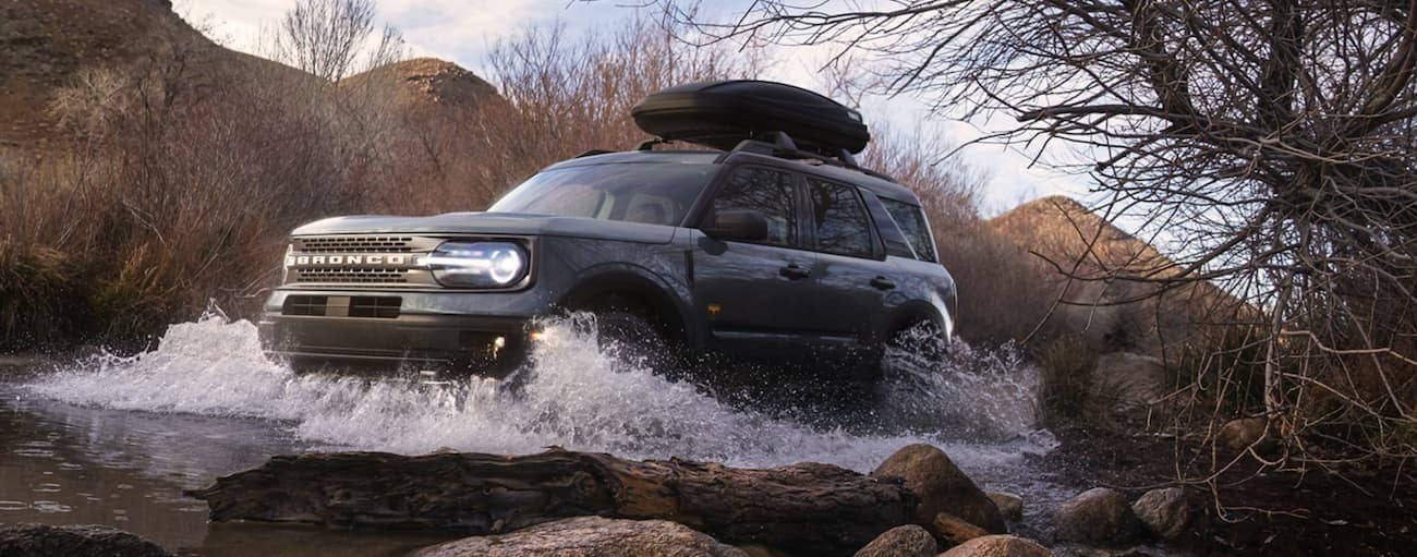 A grey 2021 Ford Bronco Sport is off-roading through a river outside of Cincinnati, OH.