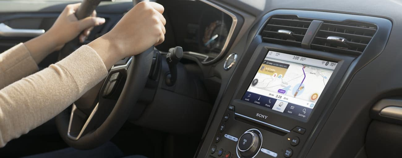 The infotainment screen in a 2020 Ford Fusion is shown with navigation.
