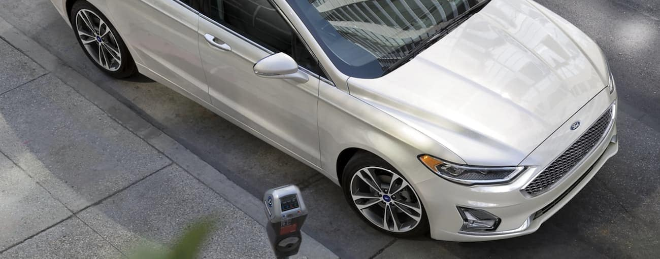 The front of a white 2020 Ford Fusion is shown from an above angle on a Cincinnati, OH, street after winning the 2020 Ford Fusion vs 2020 Hyundai Sonata comparison.