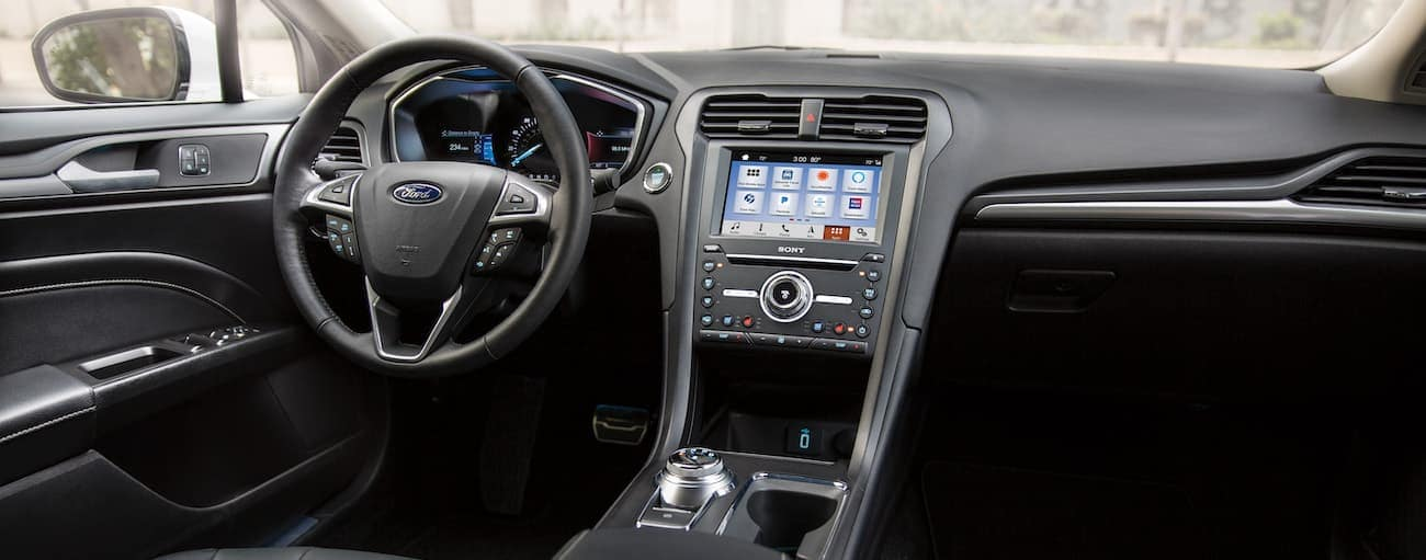 The black interior of a 2020 Ford Fusion is shown.